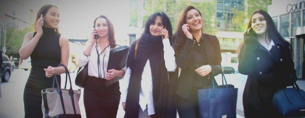 Female Lawyers with phones walking for video shoot