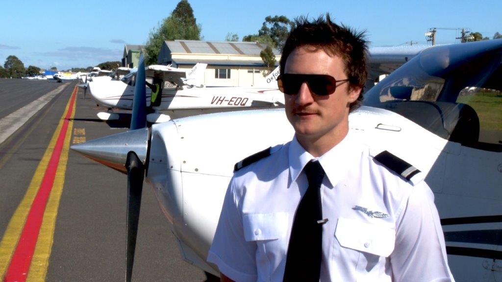 Student Pilot on airstrip giving a testimonial