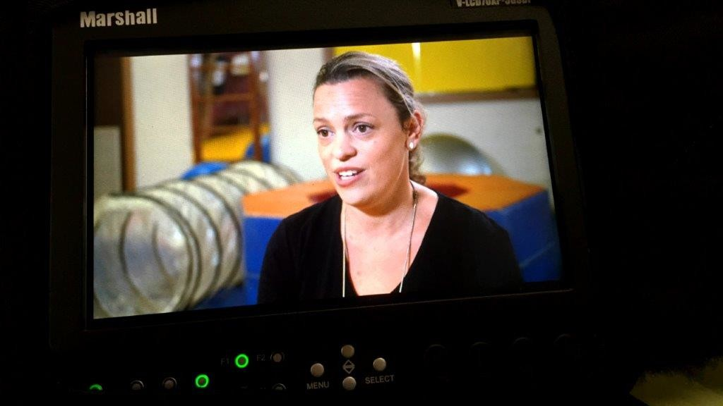 A production video monitor with interviewee on screen