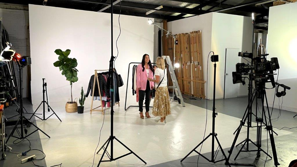 wide photo of studio with presenter and makeup artist