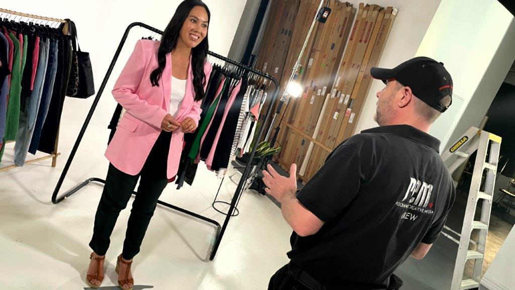 director talks to presenter in studio